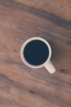 coffee mug on a wood floor