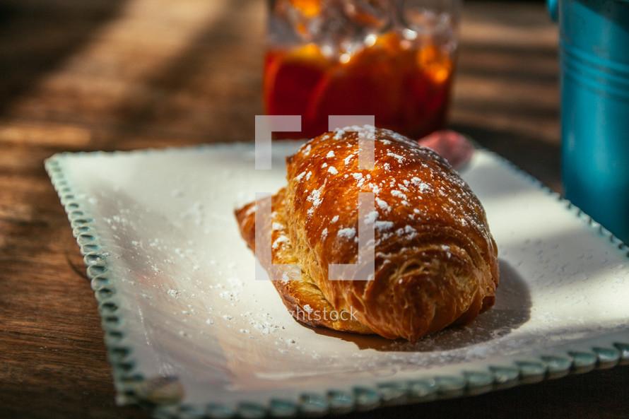 croissant and ice tea