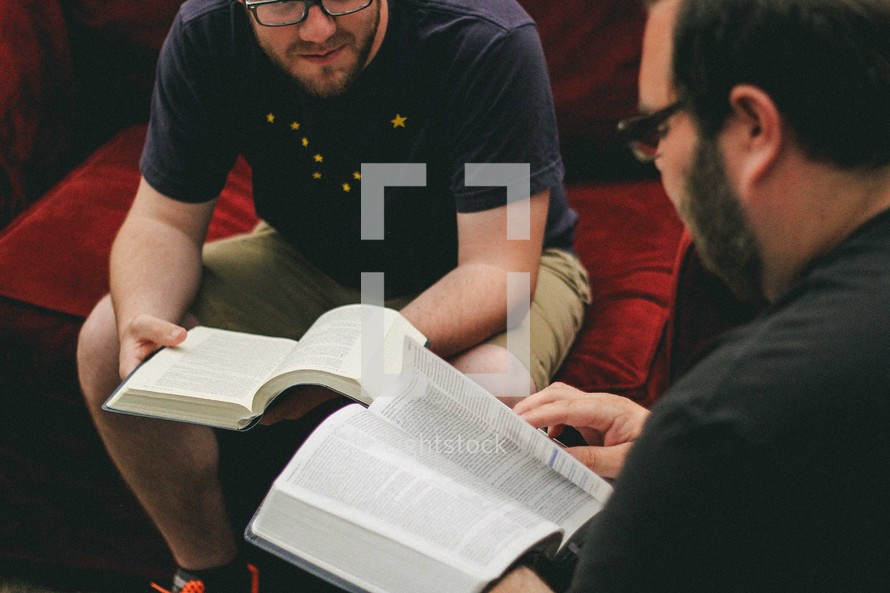 Two men studying the Bible together.