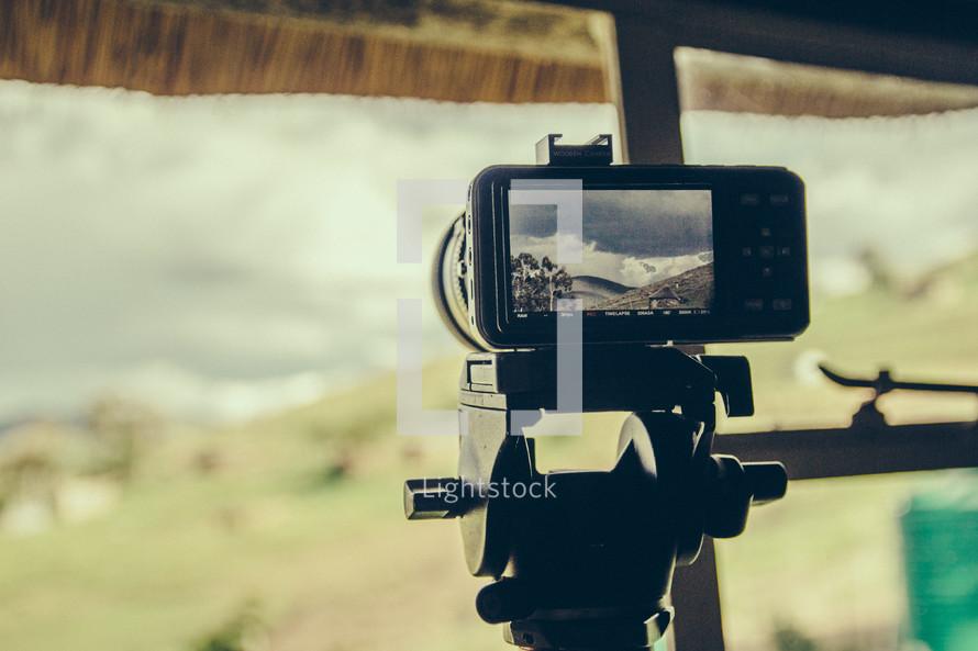 camera filming on a tripod