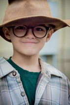 boy child wearing a hat and glasses