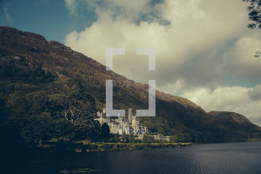 castle built into a mountain along the Irish coast