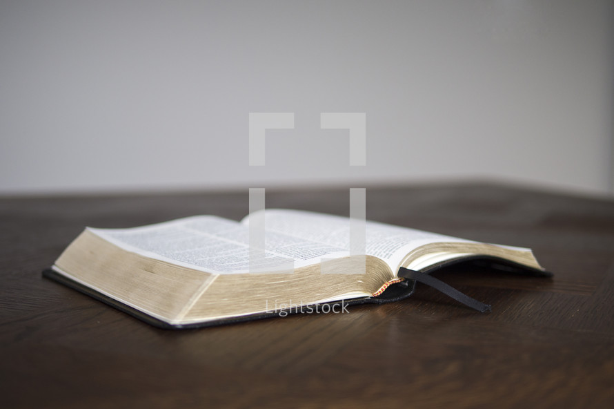 Open Bible on a desk ready for some personal devotions.