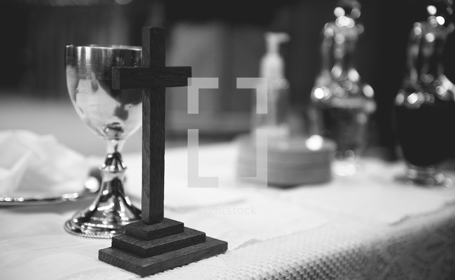 Communion table with a cross, chalice, and host.