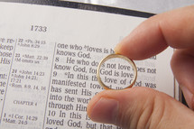 man holding a wedding ring over the words God is love
