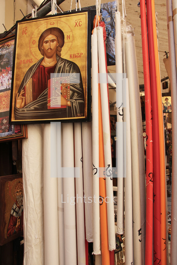 Religious icon of Jesus Christ with pairs of hand made altar candles