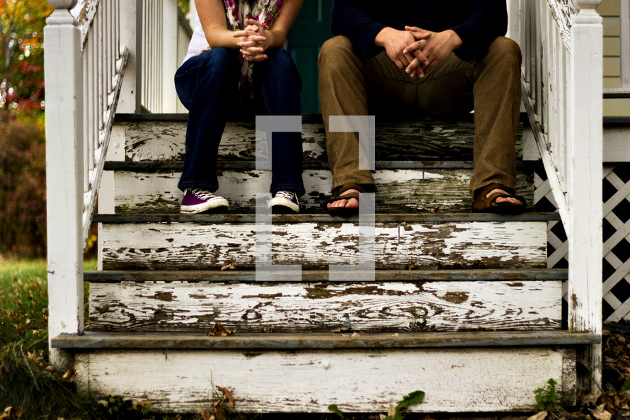 couple sitting on front steps