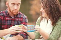 couple drinking hot cocoa