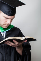 Graduate reading the Bible.