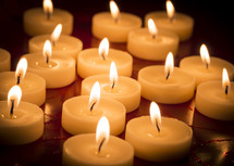 Lit votive candles.