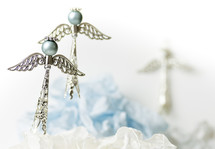 Two blue and silver Christmas angels, white background