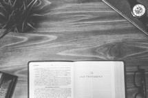 The Old testament, open Bible, Bible, pages, reading glasses, wood table