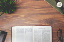 open Bible and reading glasses on a wood table - 2 Timothy