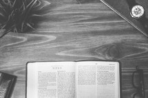 Titus, open Bible, Bible, pages, reading glasses, wood table
