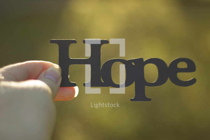 woman holding the word hope
