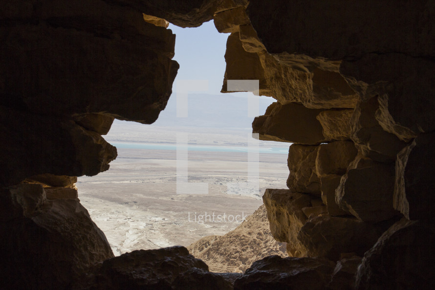 view of the holy land through the mouth of a cave