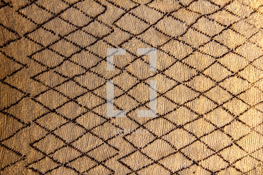 Hand made traditional woven Berber camel hair rug with black zig zag pattern