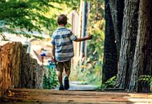 a boy walking on a path