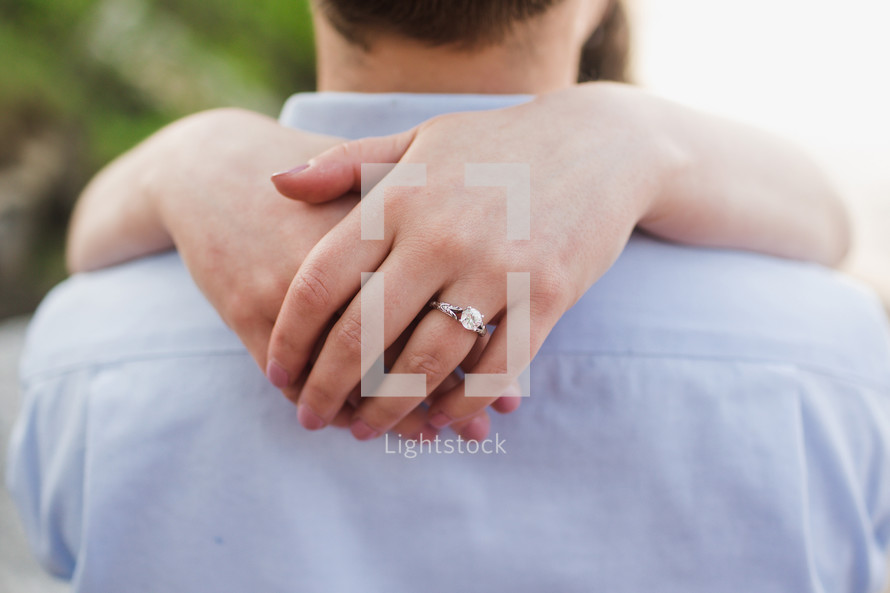 engaged couple hugging