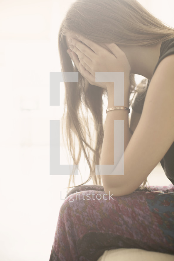 a woman covering her face