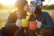 couple toasting with hot cocoa