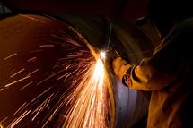 Welder torch cutting steel air arching sparks heat welding industrial shop