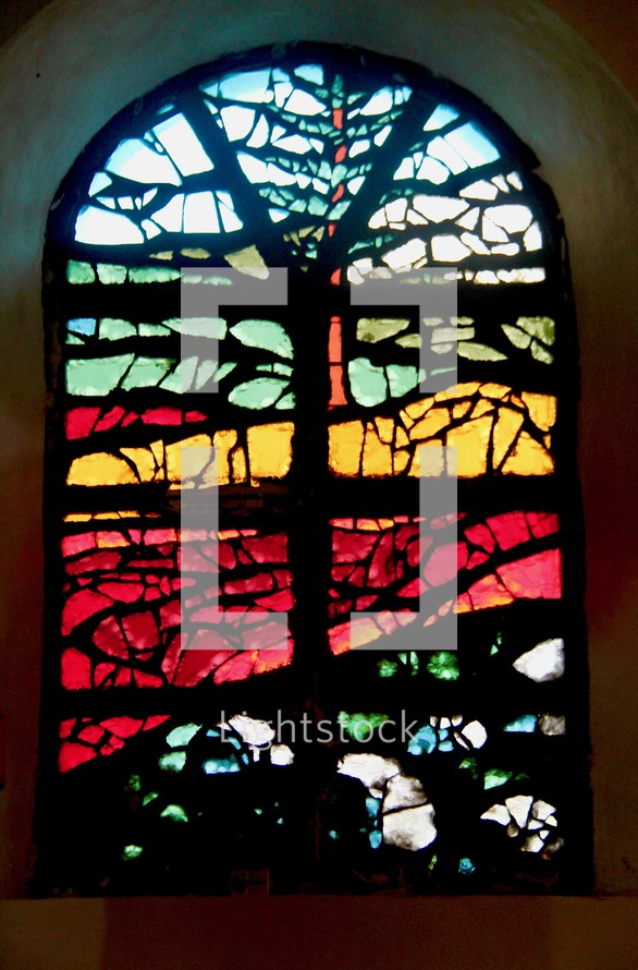 Stained glass window in the Notre Dame Des Laves Church, surrounded by volcanic lava.
