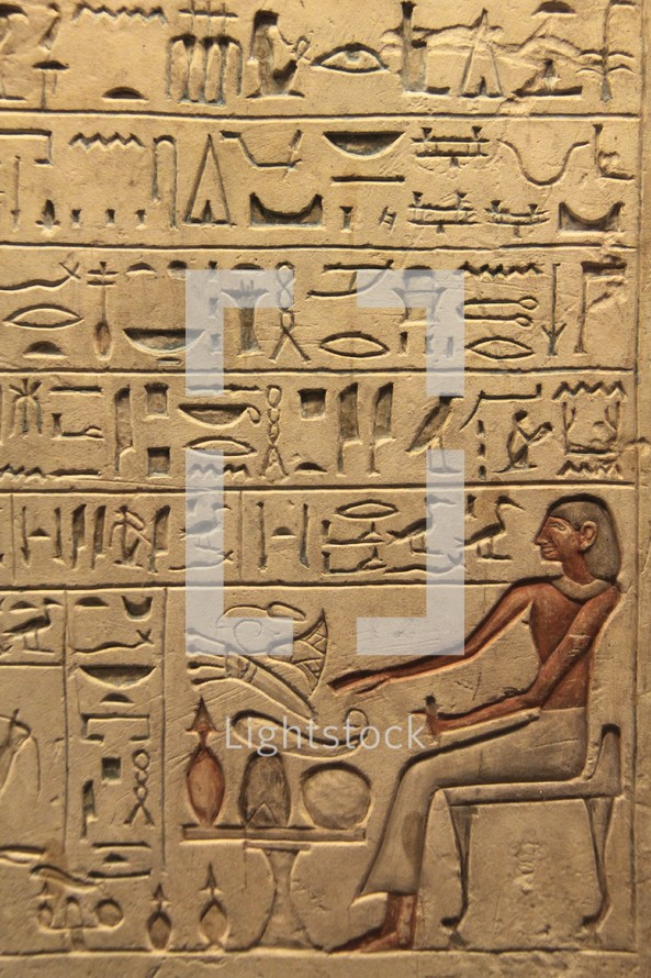 Egyptian hieroglyphics and pictograms set into a clay tablet