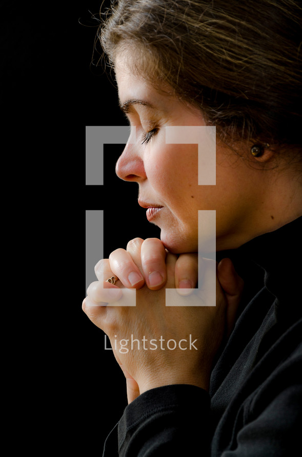 woman in soulful prayer