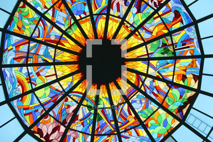 Stained glass window showing the sun, rainbow, seas and creation