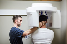 a man getting x-rays at the dentist