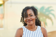 head shot of a smiling African American woman in summer
