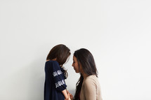 mother and daughter in studio praying