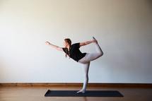 stretching in a yoga studio