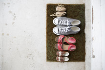 shoes on a doormat.