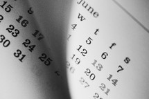 flipping through the pages of a calendar
