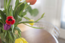 tulips in a vase on a table
