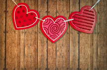 red heart banner on wood