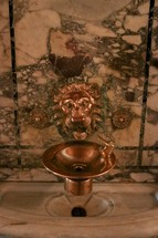 gold lion water fountain