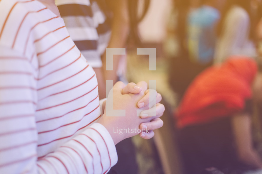 praying hands during a worship service