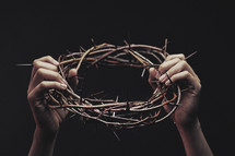 Holding Up Crown of Thorns