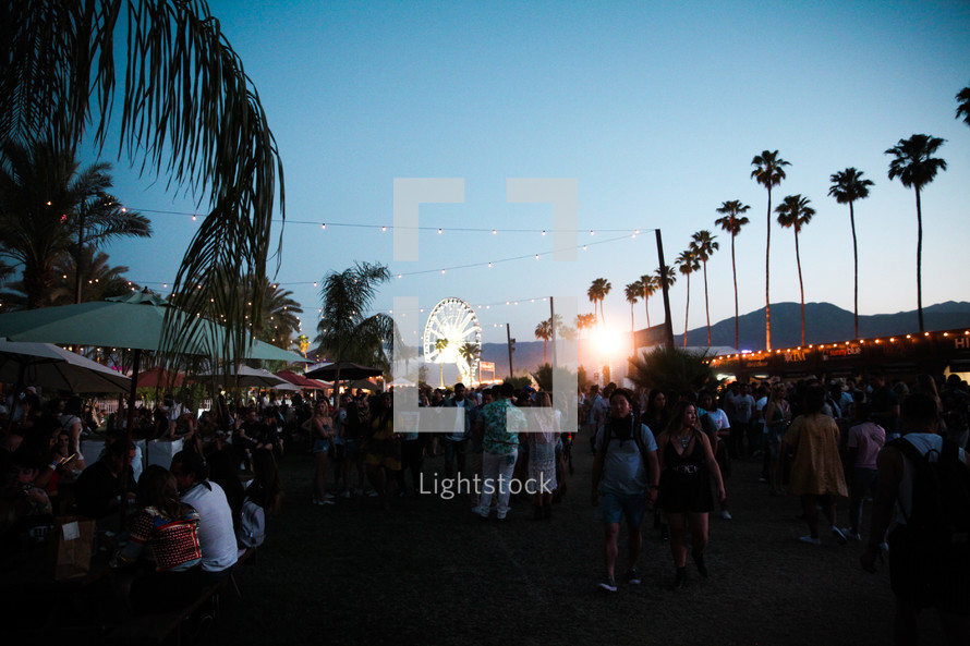 large crowd at a fair at night