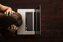 stressed woman at a laptop computer