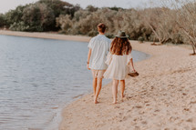 a couple walking on a beach