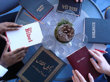 International small group -bible study.  table, cover, covers, reading, read, small group, small groups, bibles, groups, bible study, discipleship, fellowship, evangelize, hand, hands, group, community, communication