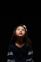 a girl looking up to God