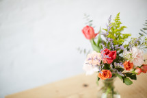 vase of flowers on a wood table