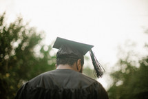 male graduate with back to the camera