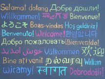 the word WELCOME written in many languages to our brothers and sisters all over the world