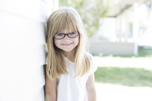 face of a girl child wearing glasses